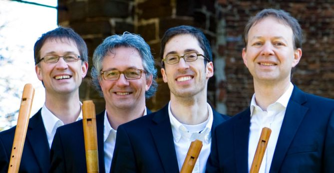 Photo of the Flanders Recorder Quartet holding recorders